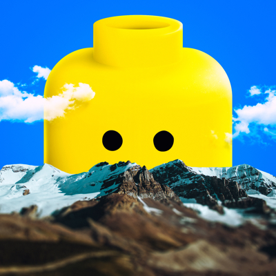 Photo collage of a huge Lego head behind mountains